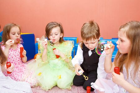 Group of preschool kids blowing bubbles at the birthday party Stock Photo - 7072738