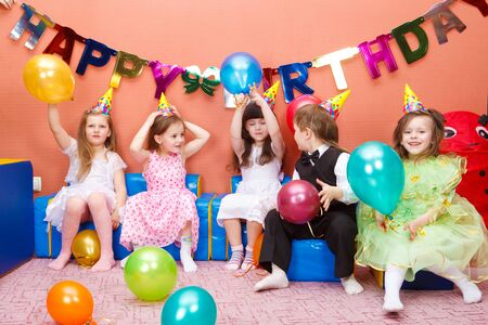 children celebration: Group of preschool kids at the birthday party