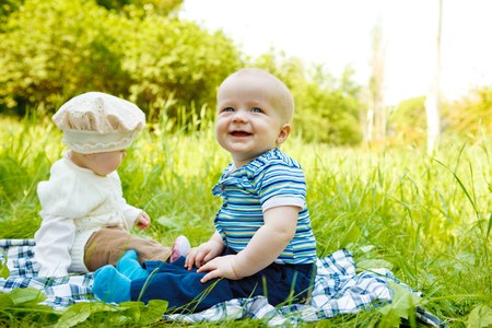Three babies in the spring park Stock Photo - 7221274