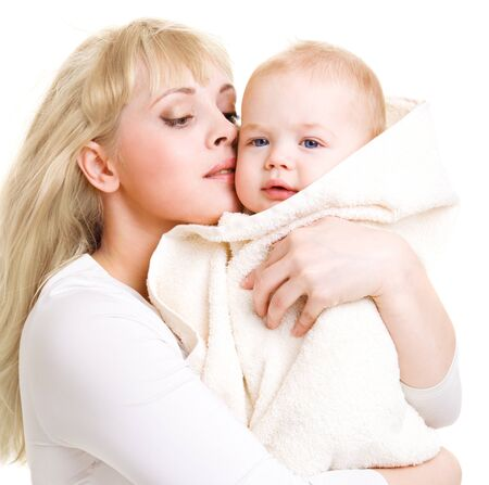 baby angel: Mom embracing her beautiful baby son covered with towel Stock Photo