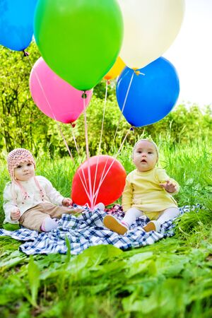 Two baby girls with the large balloons photo