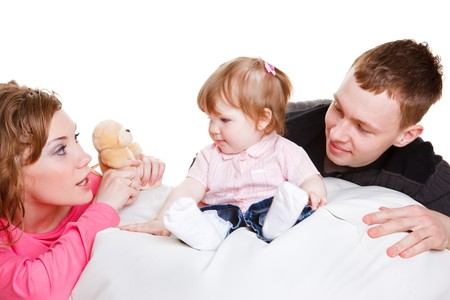 Young parents playing with sweet baby girl photo