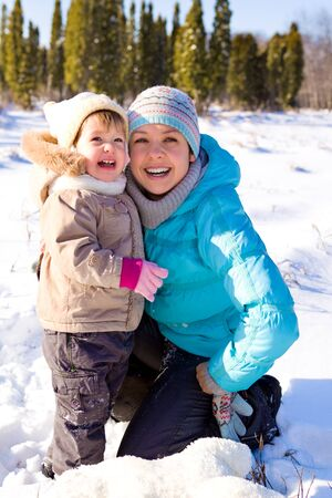 Mother and daughter laughing in a winter park photo