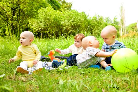 Babies playing with ball in the outdoor photo
