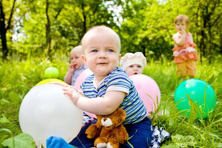 babies playing: Babies playing with balloons in the park