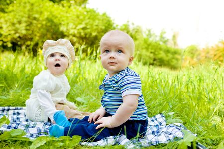 Three babies in the spring park Stock Photo - 7367458