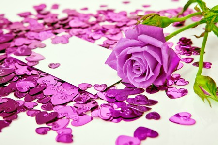 Purple rose and a blank invitation card