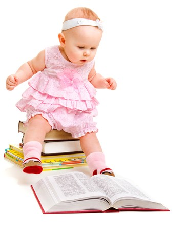 literate: Curious baby girl reading a book