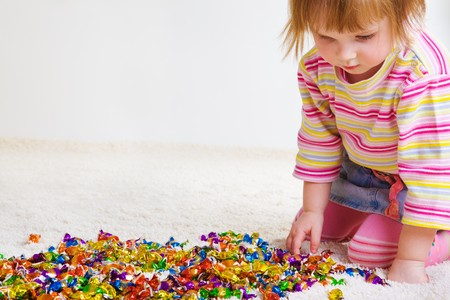 Sweet girl choosing candy photo