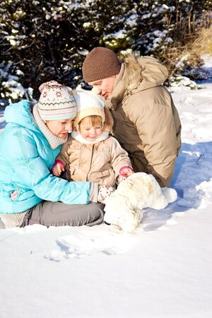 Happy attractive family playing in snow Stock Photo - 7380689