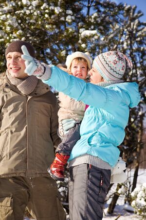 Happy attractive family in a sunny winter day photo