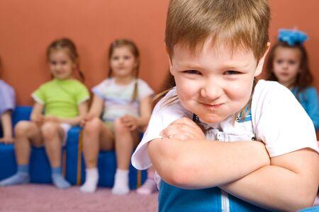 him: Preschooler, his friends behind him