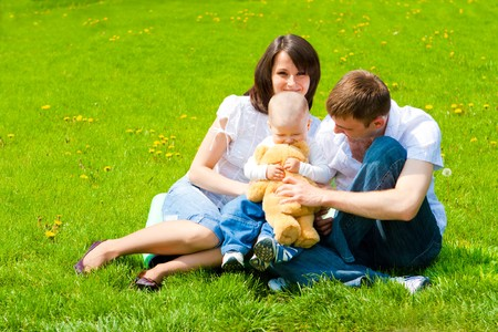 Family sitting on spring grass Stock Photo - 7449368