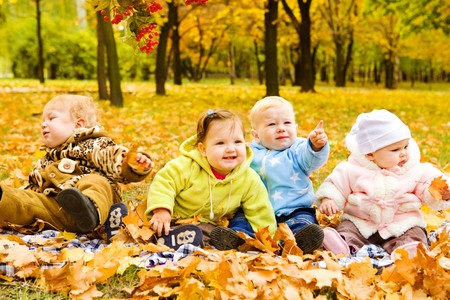 Babies group having fun in fall Stock Photo - 7449377