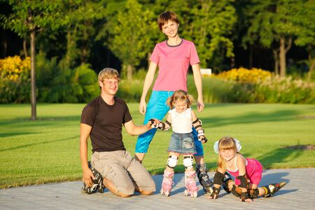 A happy family in roller skates photo
