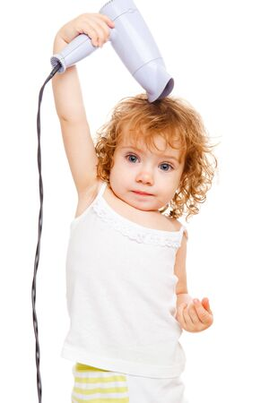 Pretty curly toddler drying her hair photo