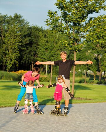 A happy family enjoying weekend in roller skates photo