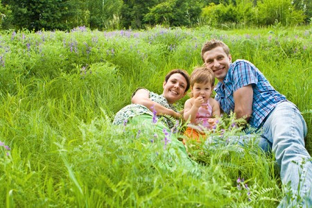 Family in green grass Stock Photo - 7449371