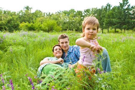 Lovely toddler in grass photo