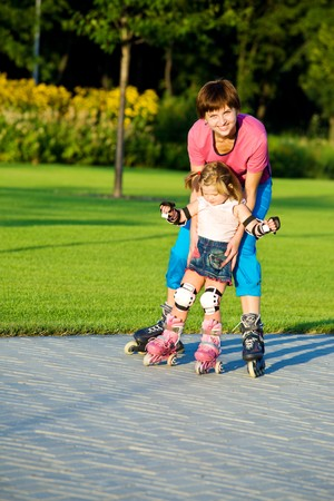 Cute girl first time in roller skates photo