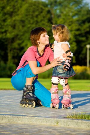 Mom and daughter in roller skates photo