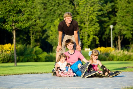 A happy family in roller skates Stock Photo - 7498414
