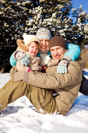 sunny cold days: Happy family in winter park
