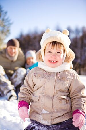 Toddler girl and her parents in a snowy park Stock Photo - 7498397