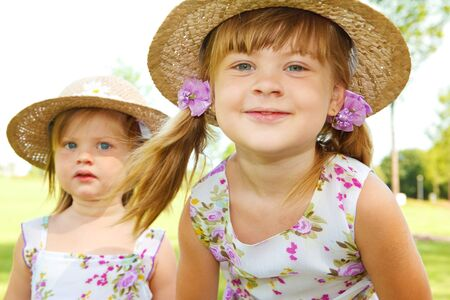 Two sweet kids in straw hats Stock Photo - 7498407