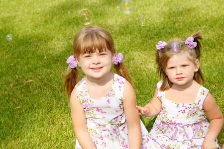 Two sweet girls looking at bubbles photo