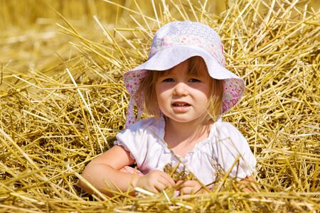 Portrait of a little girl in straw Stock Photo - 7498720