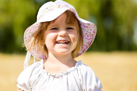 Pleased little girl in wheat photo