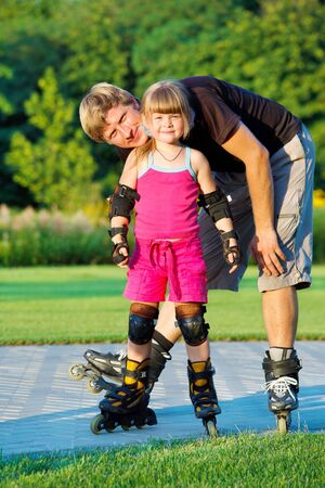 elbow pads: Dad and daughter roller-skating