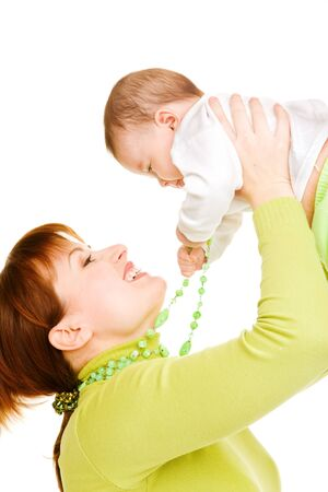 Portrait of cheerful mom holding baby in hands Stock Photo - 7596080