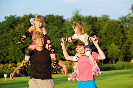 elbow pads: Happy parents with kids in roller skates