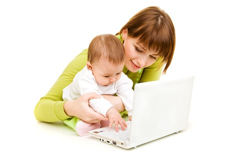 Mother and baby at the laptop, isolated photo