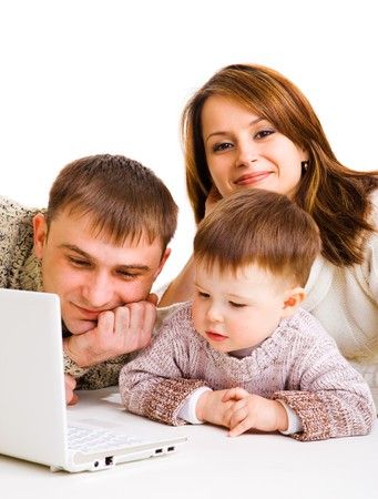 Mother, father and little boy with laptop- computer life photo