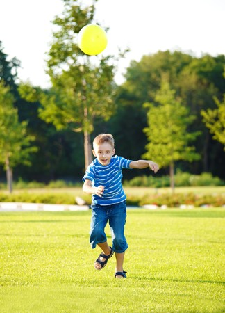 Boy running with the ball photo