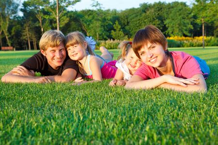 Sweet family lying on grass Stock Photo - 7613344