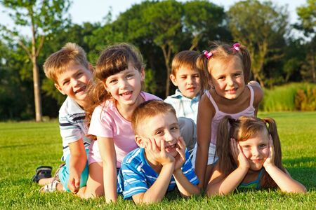 Six excited preschool friends in the backyard photo