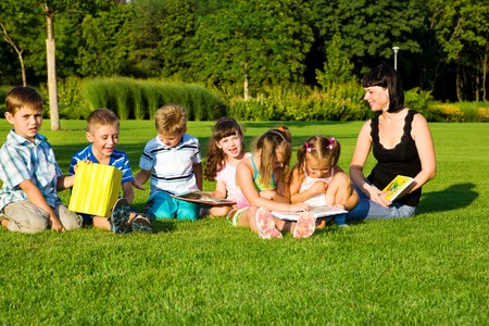 Elementary students with teacher in park Stock Photo - 7613416