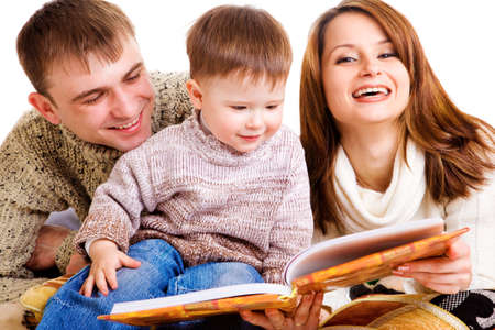 Parents reading a book to their lovely kid Stock Photo - 7613414