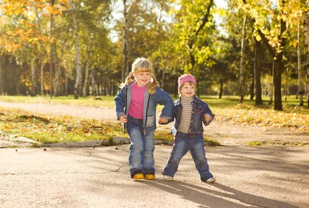 Two happy sisters in fall photo