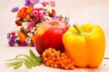 Autumnal harvest - fruit, vegetable, berries and flowers photo