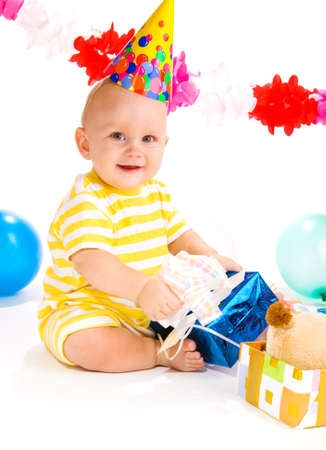 Baby in a party hat happy to receive a present photo