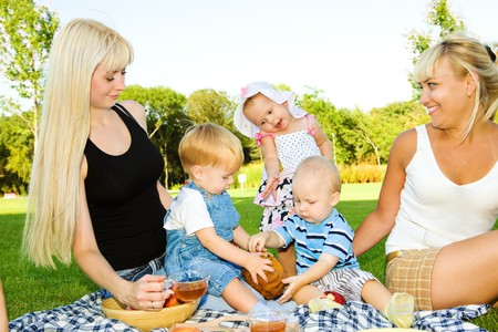 Lovely toddler kids eating cake, mother looking at them photo