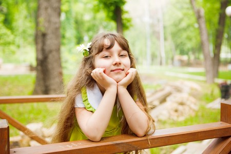 Sweet preschool girl in park Stock Photo - 7706427