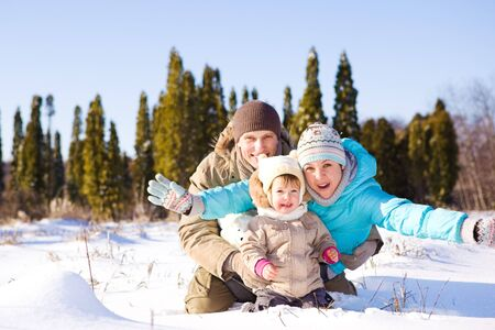 Happy attractive family having winter fun photo