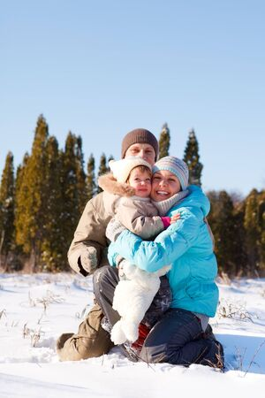 Happy young family of three in winter park  photo