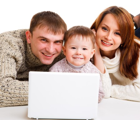 Mother, father and little boy with laptop- computer life Stock Photo - 7801598